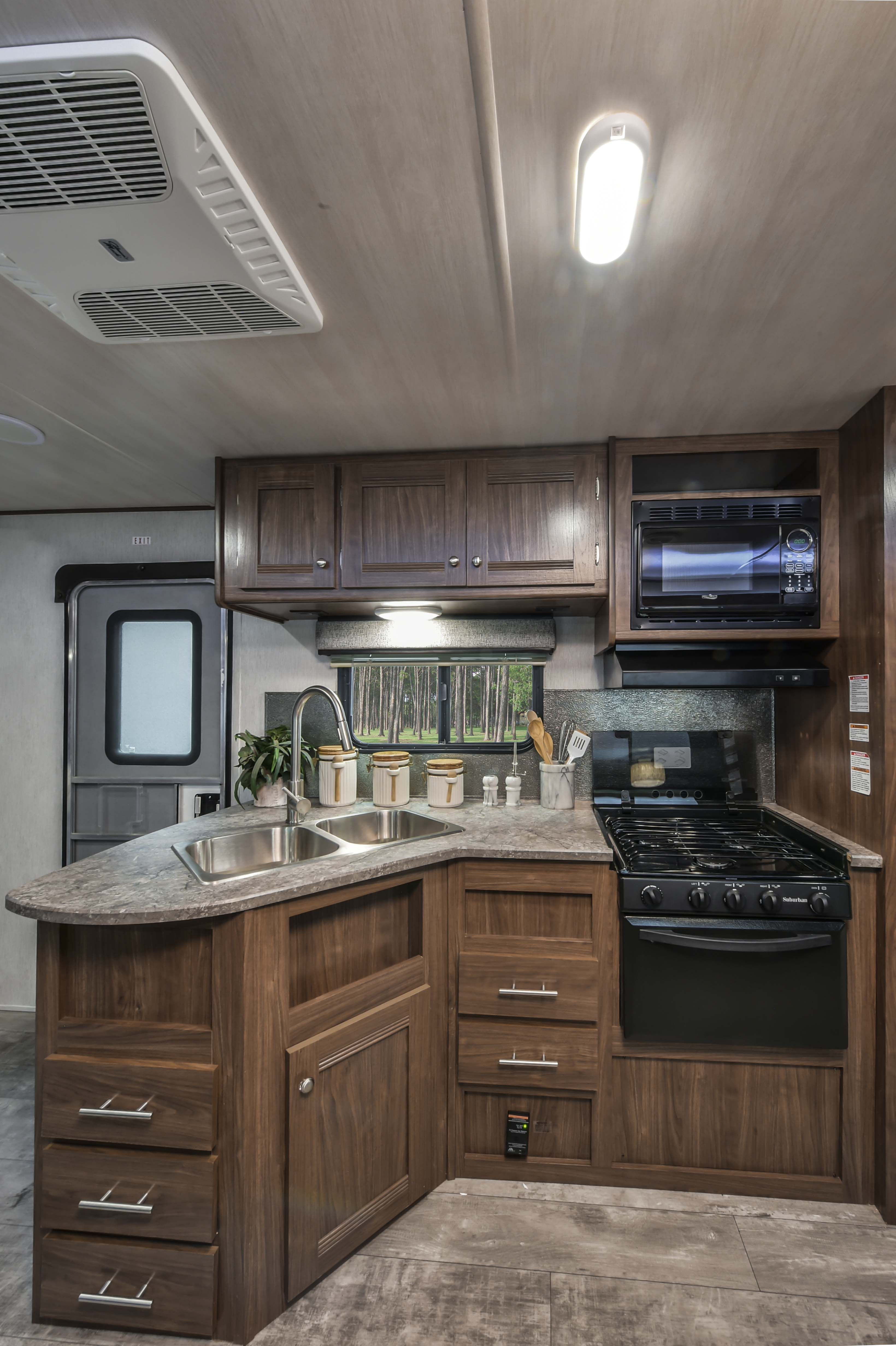 The kitchen in the 2018 Pioneer DS320 travel trailer. # ...
