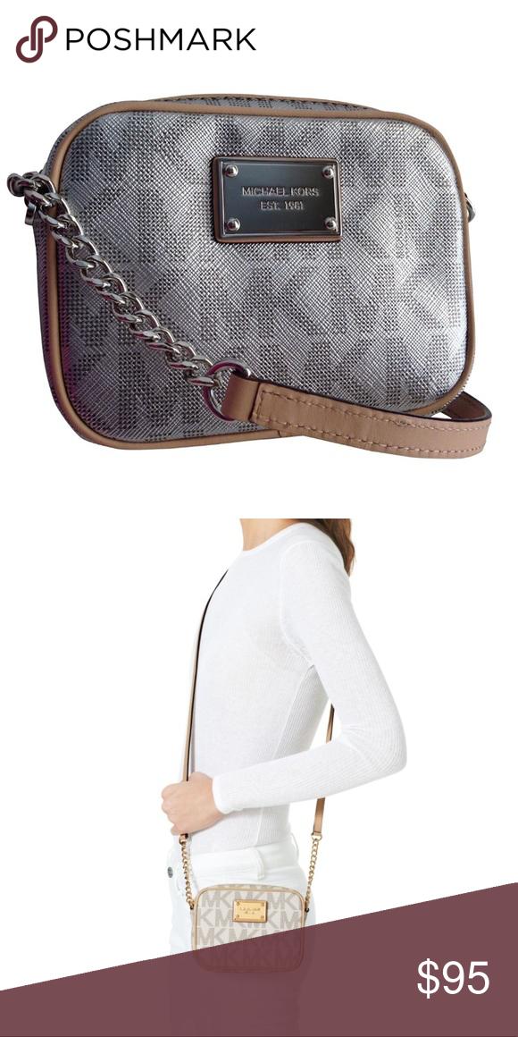 1084333d8f04 Michael Kors Jet Set Crossbody Small signature metallic crossbody with MK  logo. Tan strap with