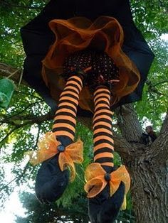 made from a dollar store umbrella to set the mood a floating witch in the tree.