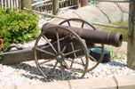 Classic Field Cannon prop  Features: Fiberglass cannon and wood spoked wheels