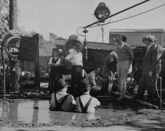 """Laurel and Hardy Behind the Scenes of """"Towed In A Hole""""."""