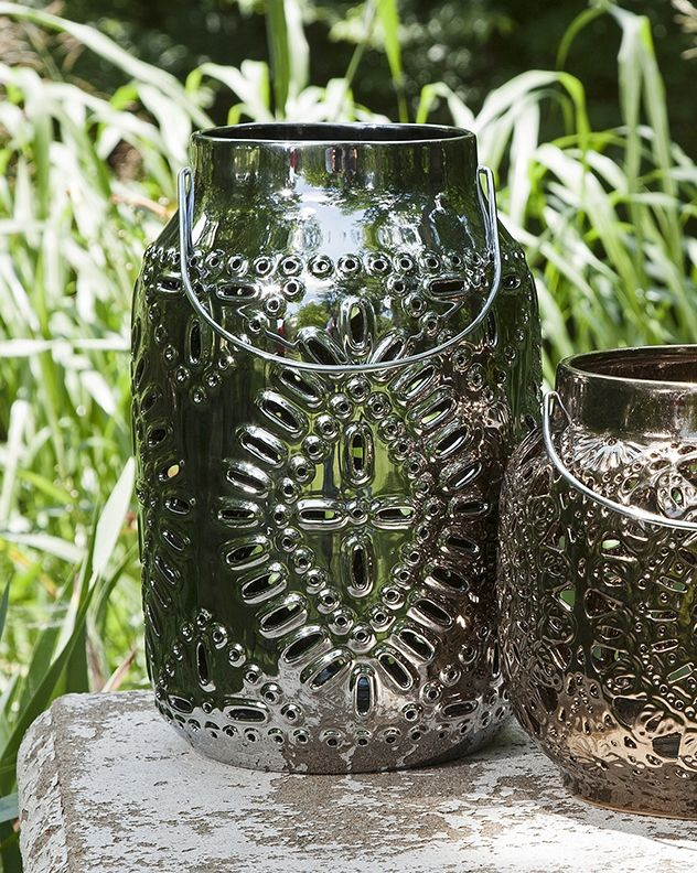 """This medium elegant lantern will instantly refresh the look of your space with an elegant, modern look. With its intricate cutwork pattern, this lantern will bring added depth and texture to any space. (13""""h x 8.75""""w x 8.75"""") - $55.00"""
