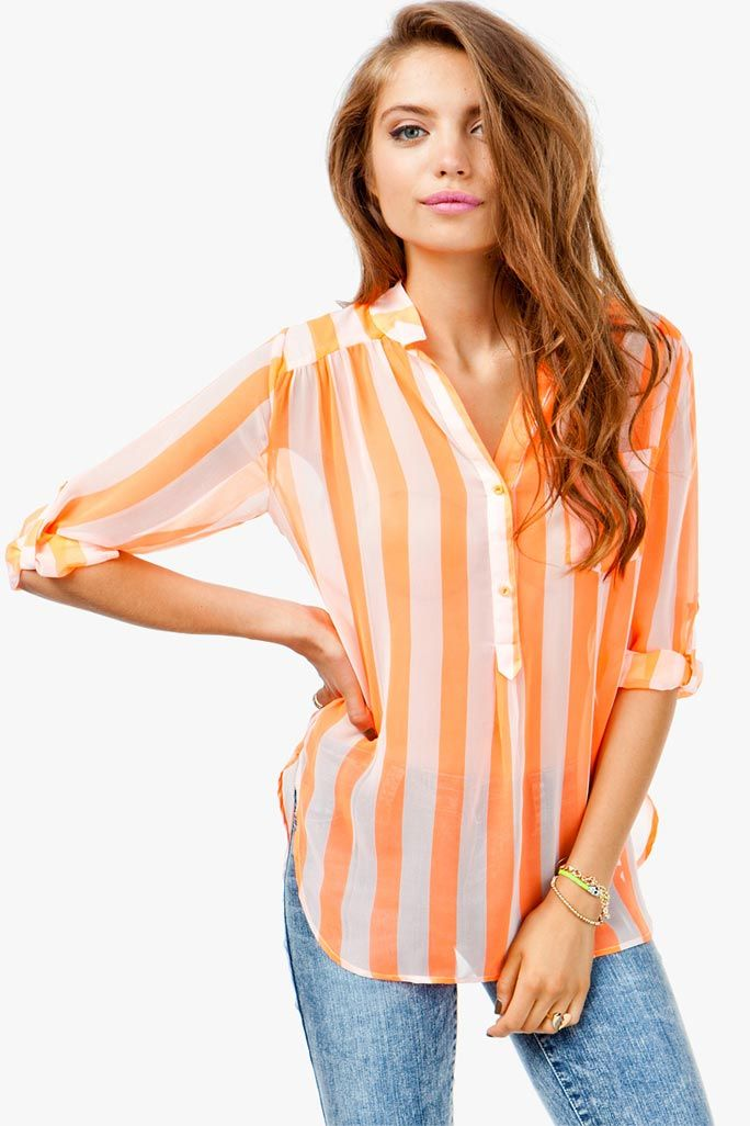 Cause a scene in neon. A loose fitting tunic top with a neon striped body. Sheer chiffon body. Roll tab sleeves. Hi-lo silhouette.
