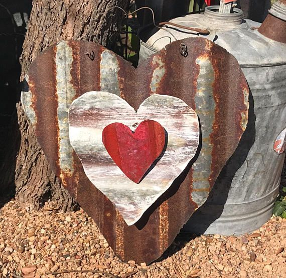 I Created This Heart From Rusted Tin And Added 2 Smaller Hearts To The Center In Contrasting Colors And Angles A Twiste Rustic Tin Sheet Metal Crafts Barn Tin