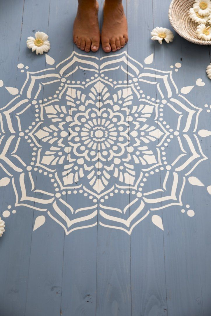 love this white painted mandala stencil pattern on blue painted floorboards. Click through for more ideas you'll love