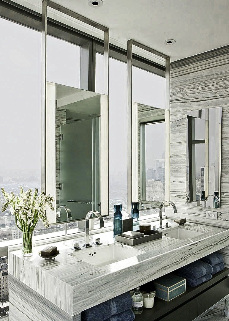 Led Mirrors suspended from the ceiling at One Madison Park ...