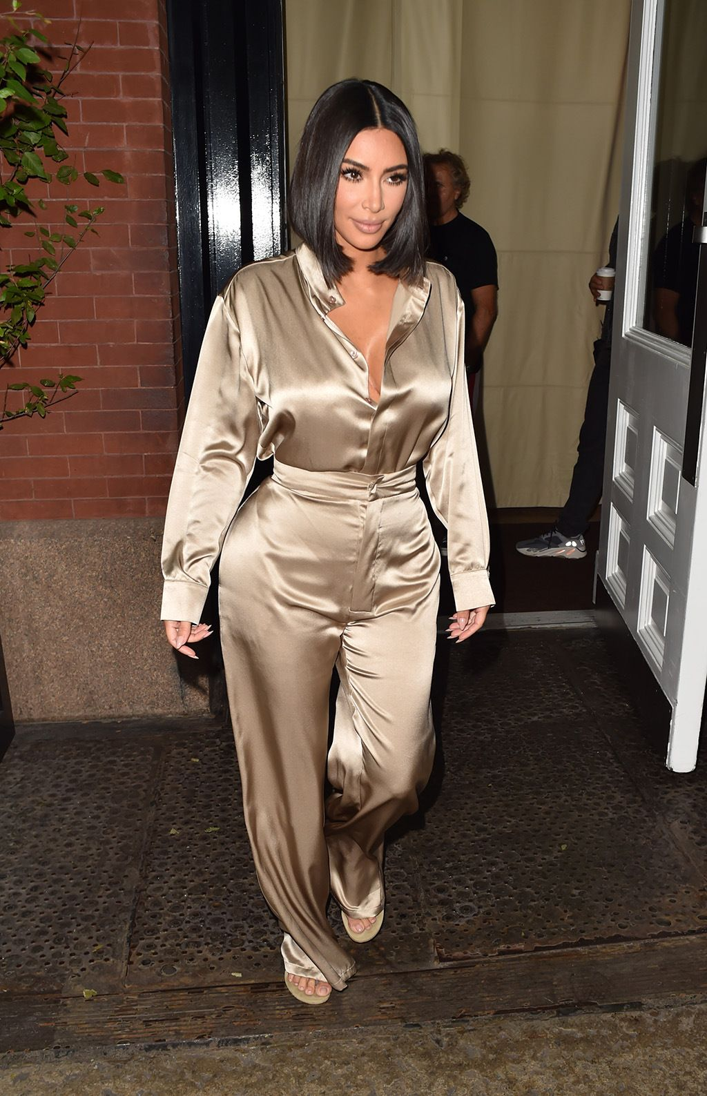 Kim Kardashian Wears Her Go-To Thong Sandals With a Silky Set in NYC