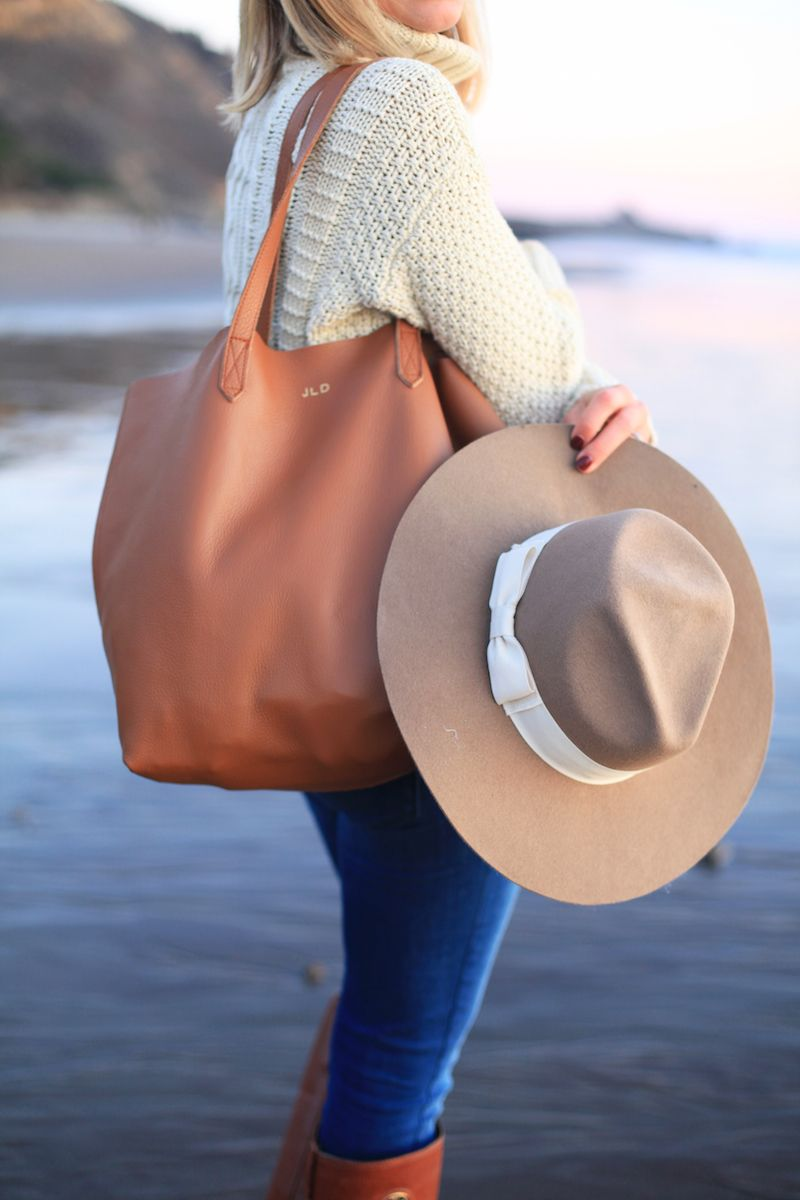 cable knit sweater, cognac bag and creme hat
