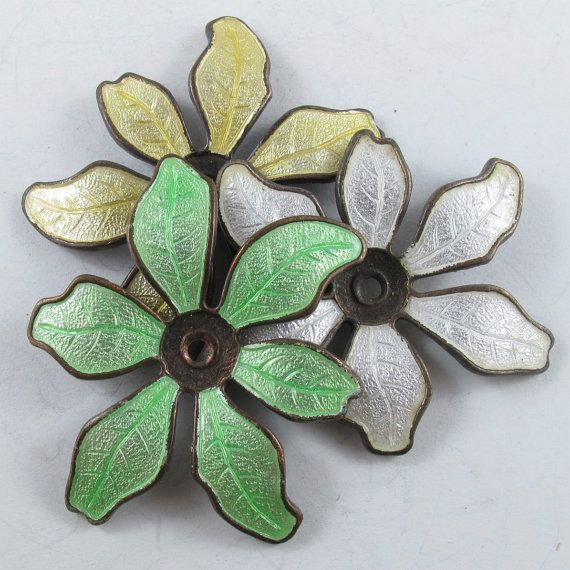 Vintage enamel floral findings have a lovely glow.