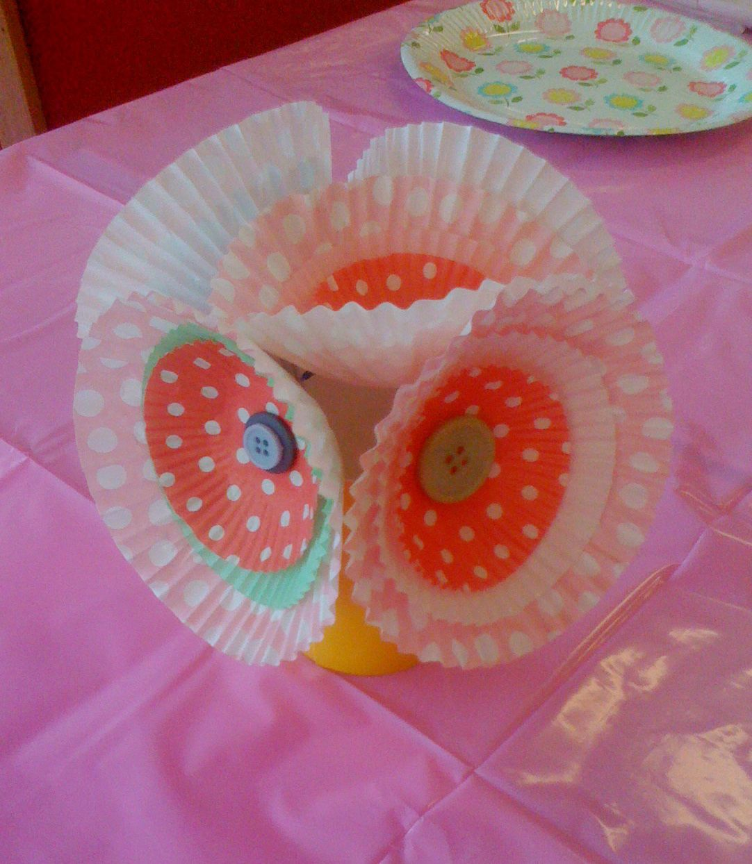 Cupcake liners made into a bouquet for table display at a children's party. Afterwards the girls wore them as hairclips.
