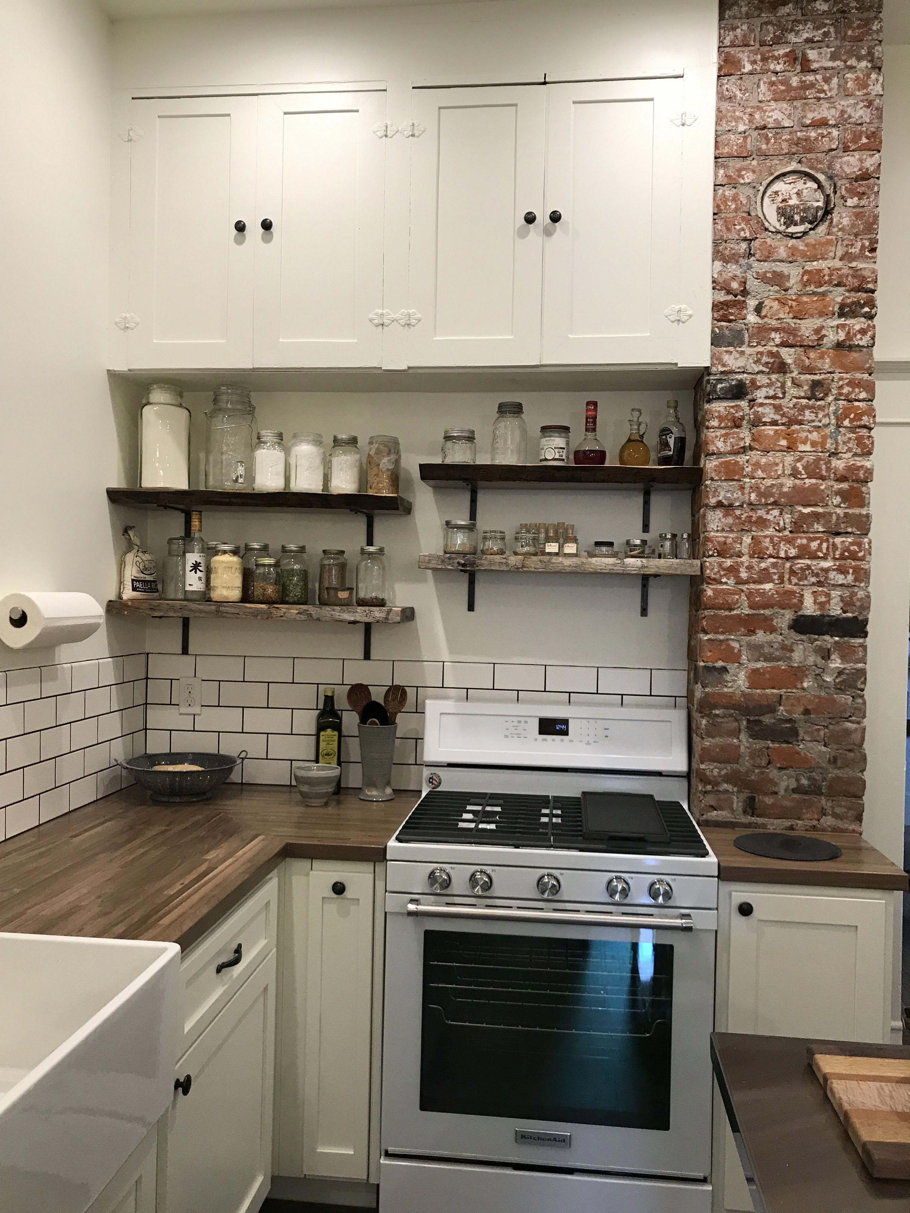 Old House Kitchen Remodel With Blue Pine Raw Edge Shelves Exposed Brick Chimney And Butcher Block Counters Chi Bungalow Kitchen Kitchen Design Brick Kitchen