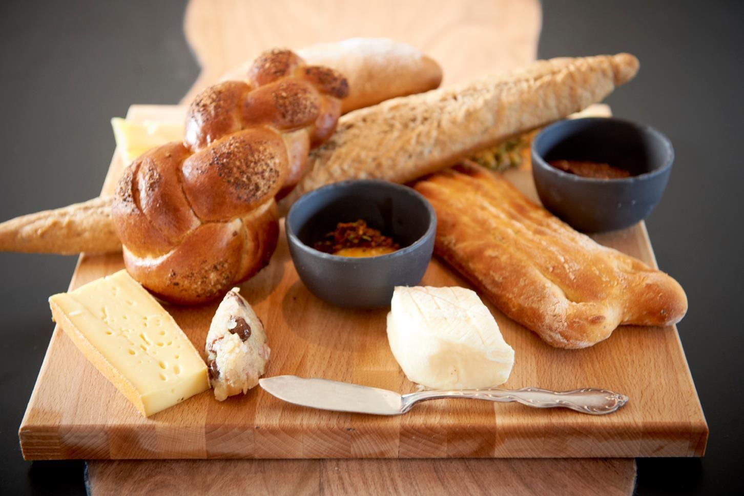 Baguette En Bois Decorative various baguettes, pastries, chorek and cheeses on a wooden