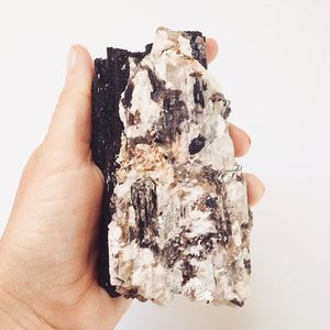 This baby is so cool. A large chunk of Black Tourmaline with Pyrite and Calcite.  BLACK TOURMALINE is one of the most protective stones out there. It wards against negative or dark energy and can even pretty against black magic. PYRITE gives power and courage. CALCITE neutralizes tension, stress and negativity. ✨MESSAGE TO PIRCHASE✨
