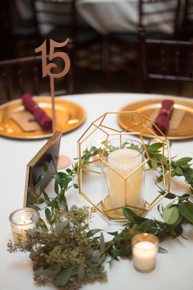 I loved our centerpieces geometric metallic table