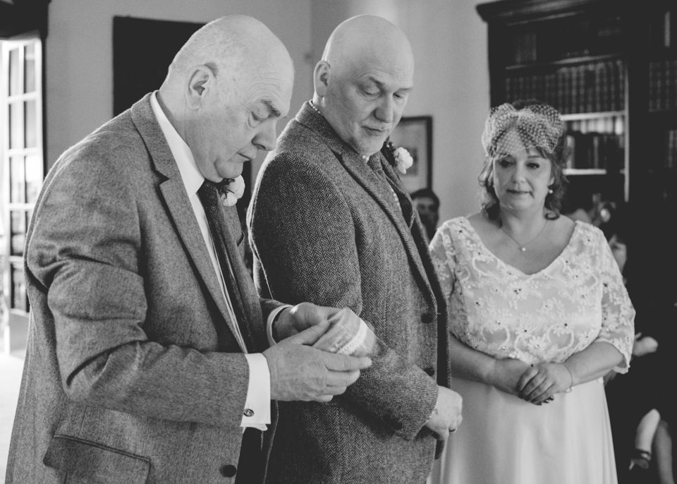 The exchanging of Rings.  Julie & Tony's Wedding February 2016.  Hemswell Court.  Victoria Gray Photography, Scunthorpe.