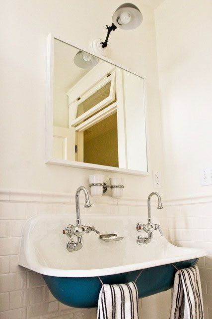 KISS - Keep It Simple Stupid! Make one fixture the focal point of the room (in this case, it's the gorgeous sink) while sticking with neutral and monochrome for the rest of the room to give your bathroom the air of sophistication.