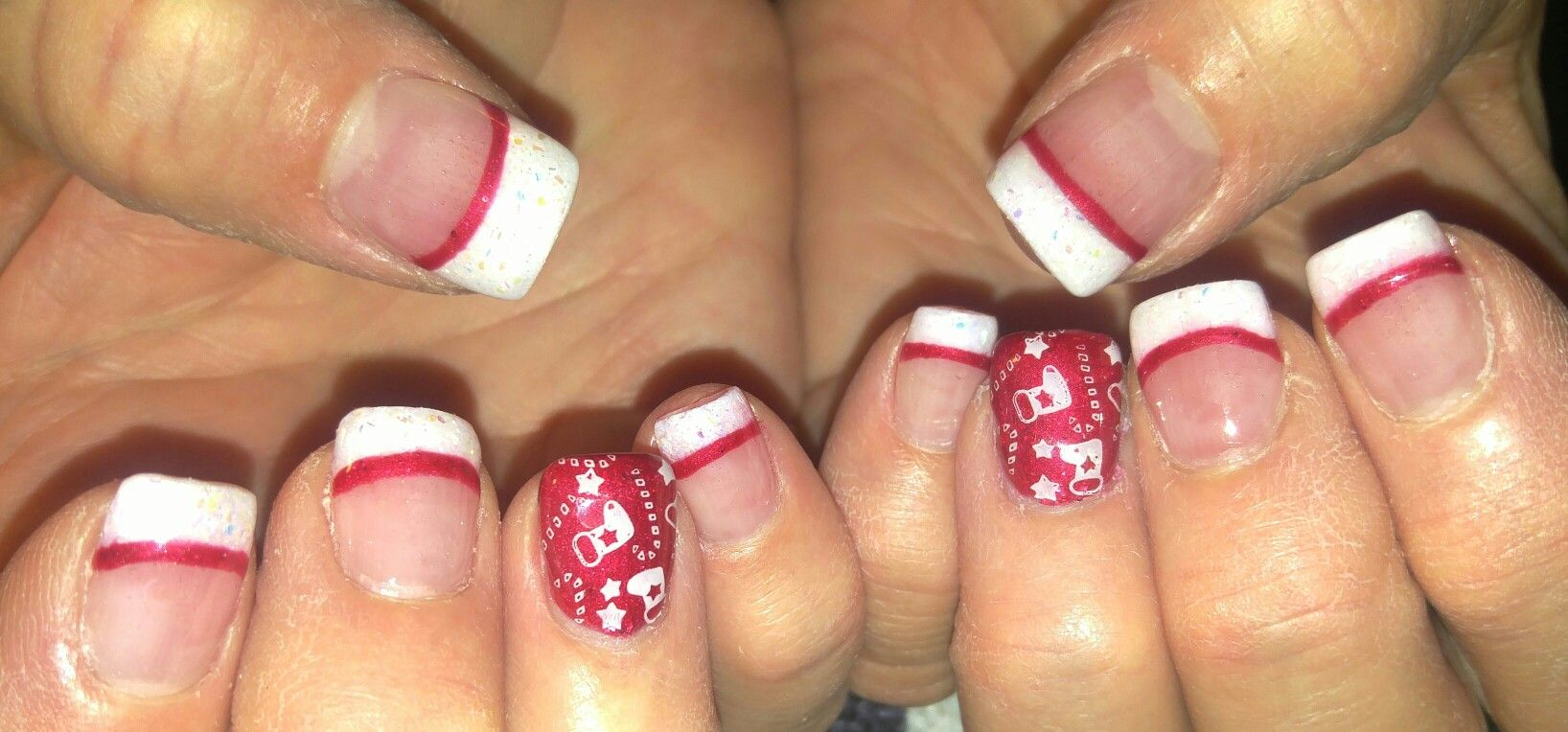 Christmas Stocking Inspired Nails Glittery Pink And White French Tip Acrylic With Stamped Nail Art A Hand Painted Red Line Gel Top Coat