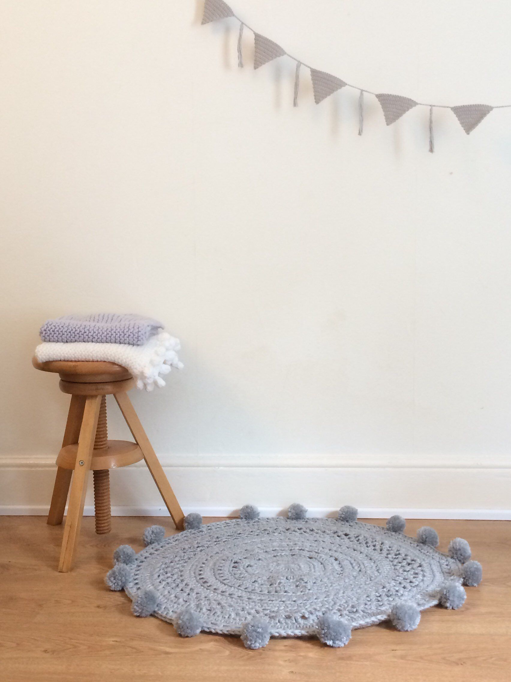 Grey Rug With Pom Poms Nursery