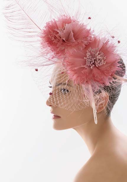 4af7f7828a955 6-rosa-clara-2012-tocados-fiesta