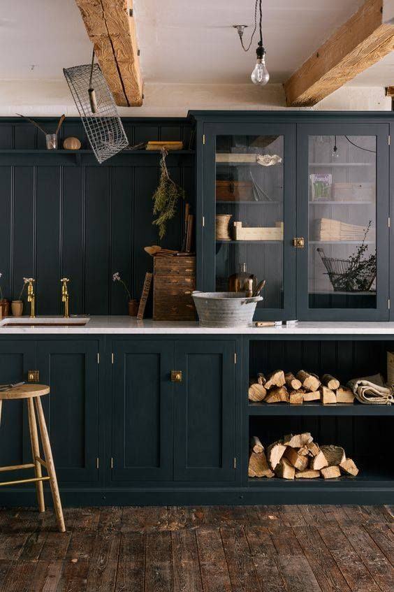 Farmhouse Kitchen With Navy Blue Cabinets And Light Countertop
