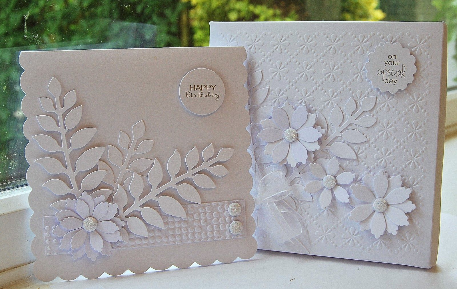 handmade cards from Kath's Blog......diary of the everyday life of a crafter ... white on white ... die cuts ... embossing folder texture and some pre-made embellishments ... delightful!