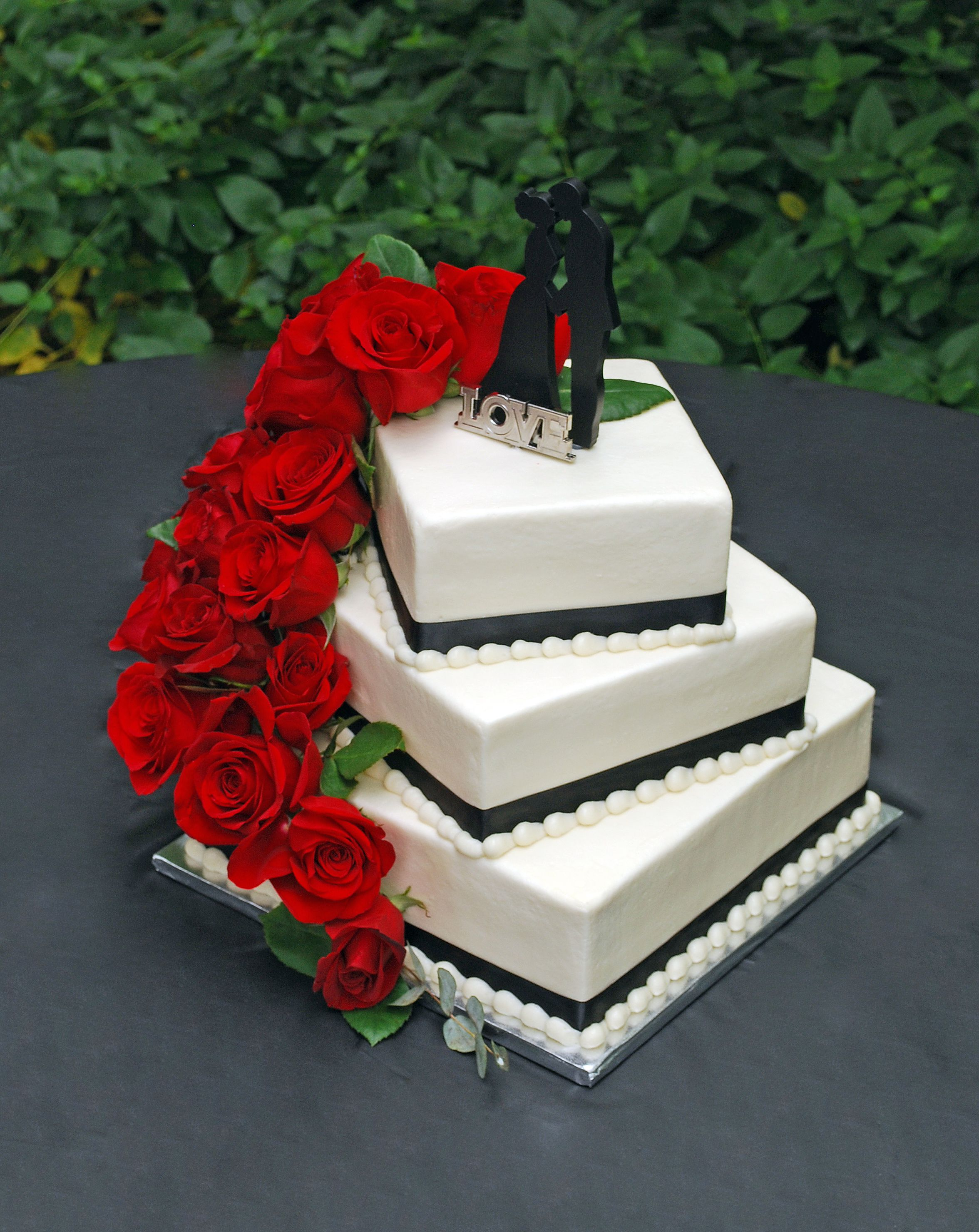 Square Spiral Stacked Wedding Cake With Cascading Roses