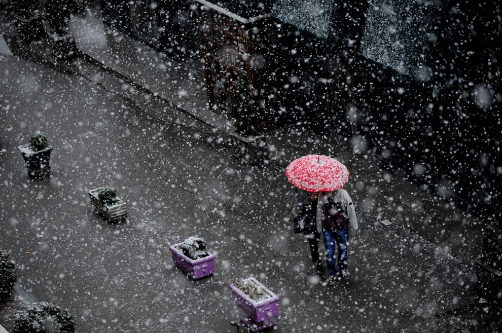A couple walk under an umbrella during a heavy snowfall in Pristina, Kosovo, on Dec. 5. (Arment Nimani/AFP/Getty Images)
