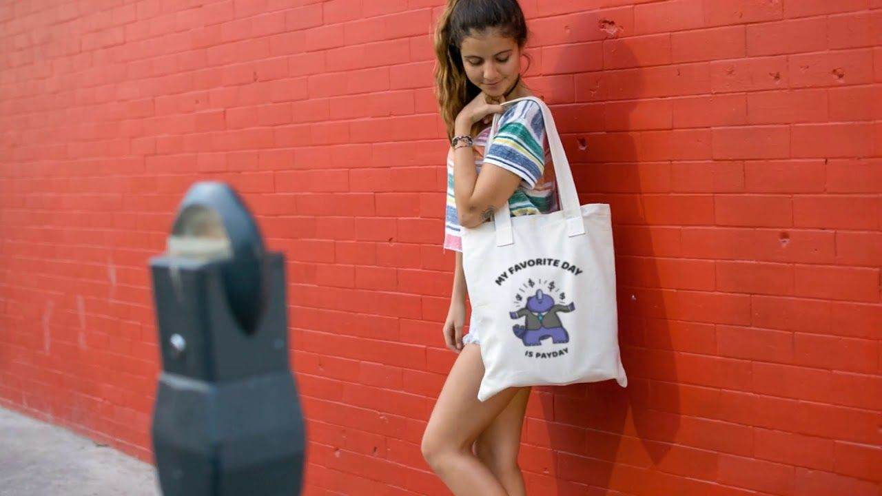 Download Young Pretty Girl Carrying Tote Bag Video Against A Red Wall Tote Bag Tote Bags