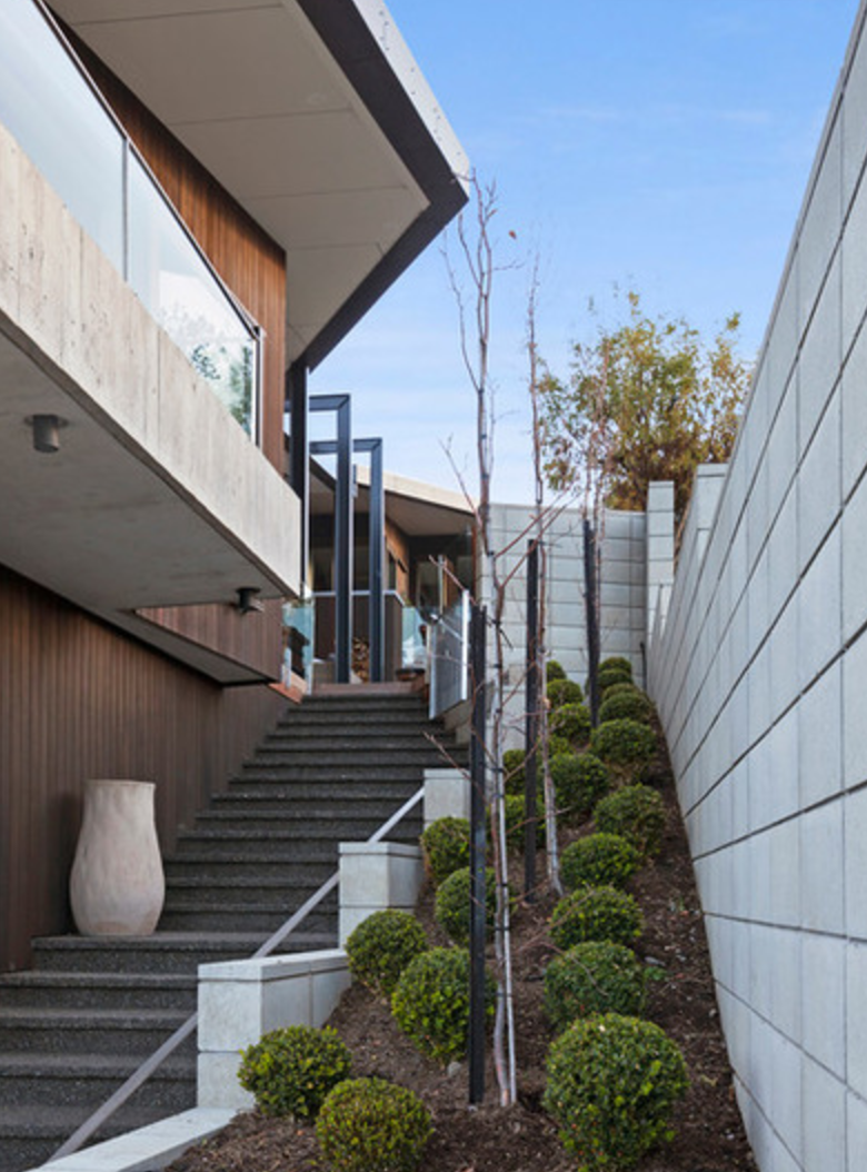 Side Access On A Steep Slope Block. Teps Lead From The Driveway To The  Courtyard