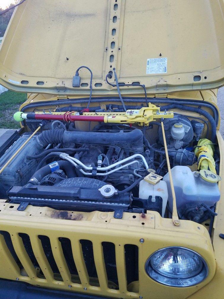 Hi Lift Jack Mounted Under Hood Of Jeep Lj Hi Lift Jack Mount