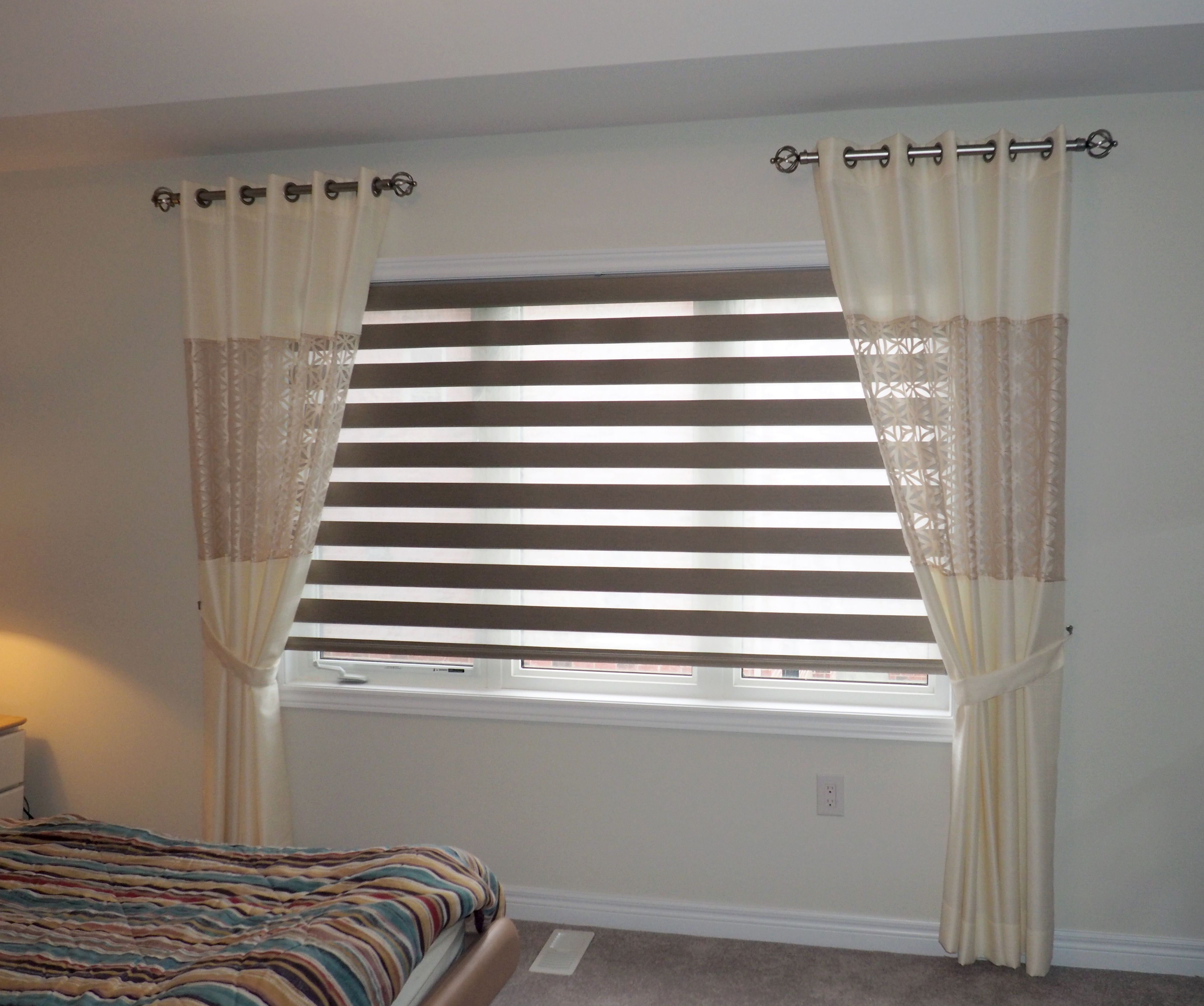 Light blocking window treatments - This Bedroom Uses Light Blocking Combi Blinds And Added Side Panel Curtains To Enhance The Size
