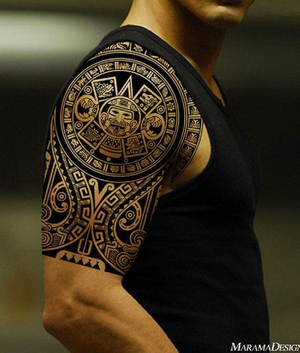 The Polynesian Tribal Arm And Chest Tattoo Incorporate A Variety Of