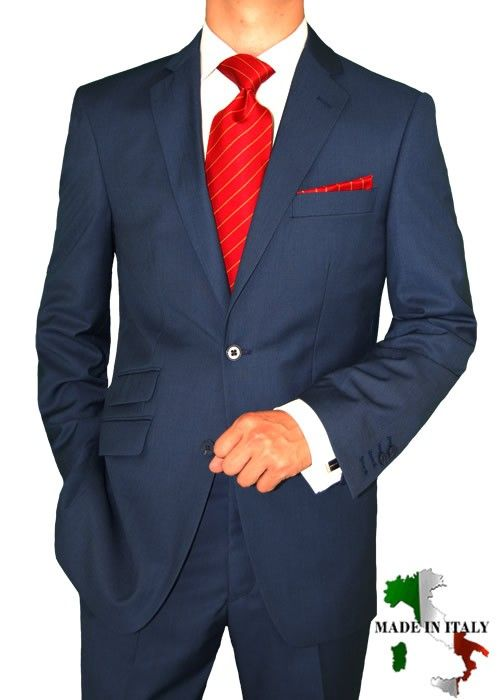 Red tie, white shirt & navy blue suit.