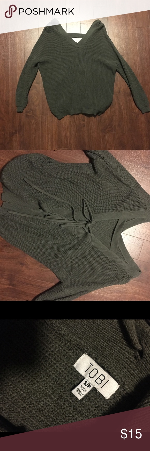 Lace up back green Tobi sweater Forrest green Tobi sweater, super comfortable, open back with lace up on bottom, loose fitting, good condition, use offer button to negotiate and comment with any questions! Tobi Sweaters V-Necks