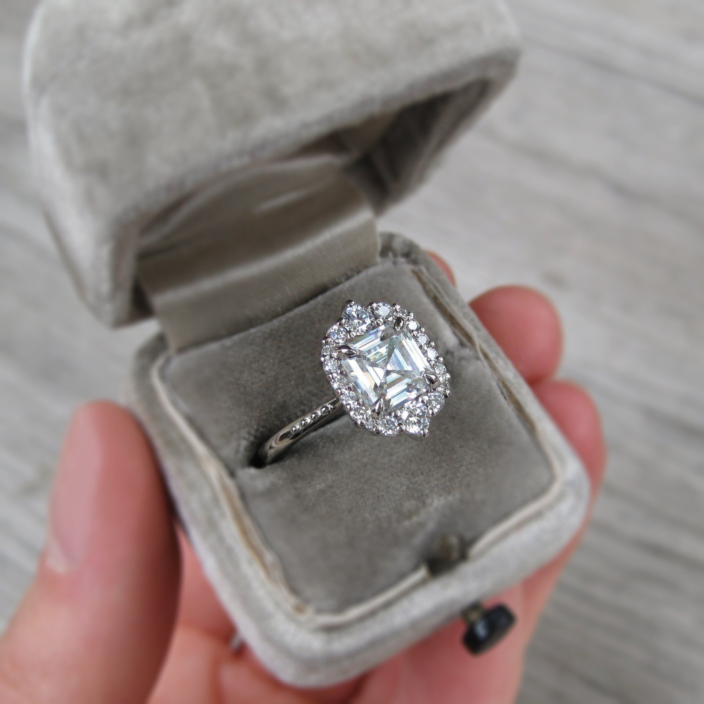Asscher cut forever one moissanite halo engagement ring with