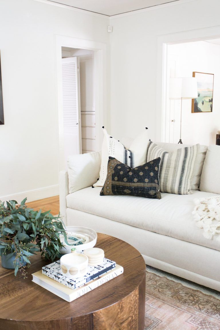 White Couch In A Boho Styled Living Room With A Round Wood Coffee Table Design Shop Interiors Trendy Living Rooms Living Room White Shop Interiors