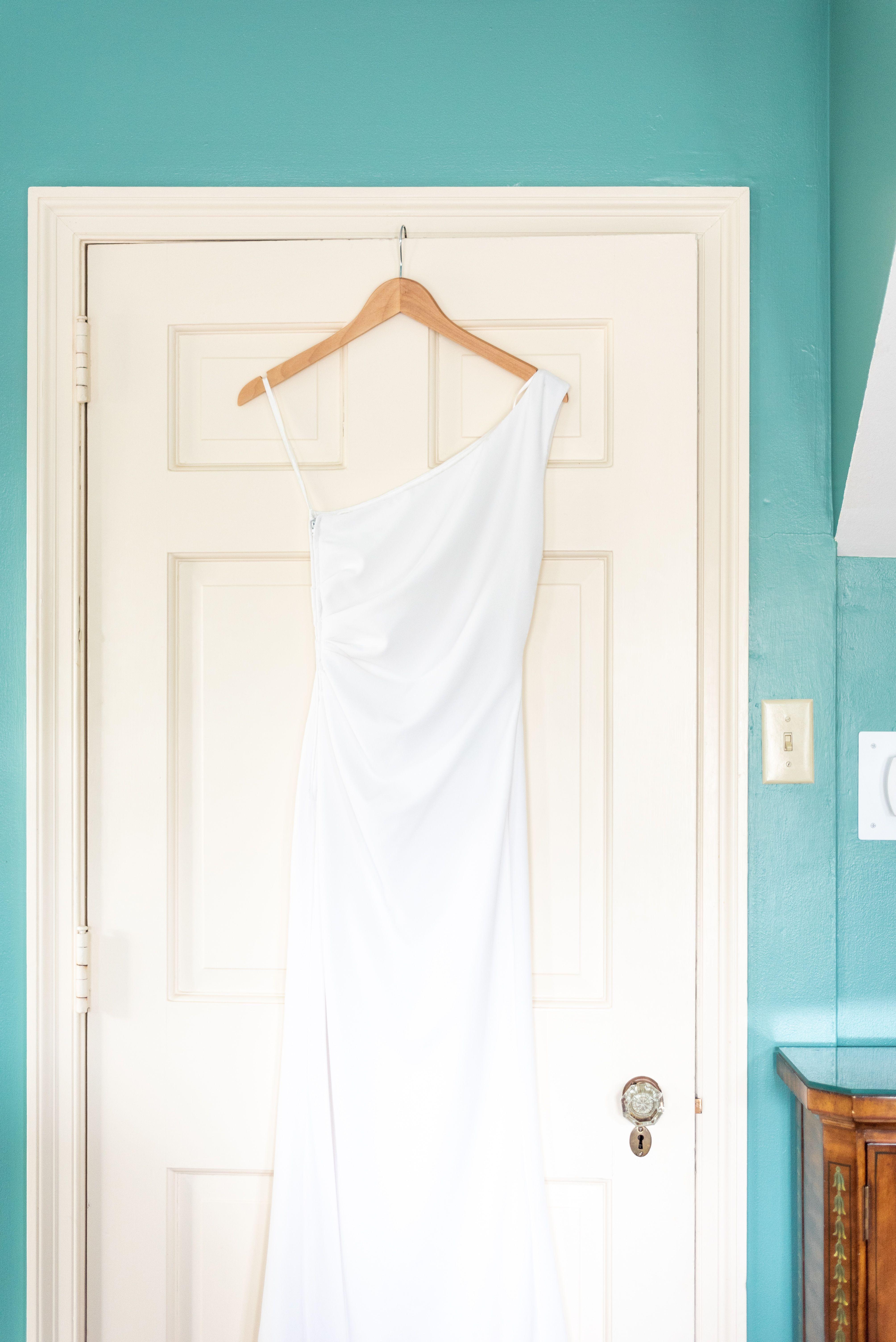 White wedding dress teal bridal suite tan door an intimate