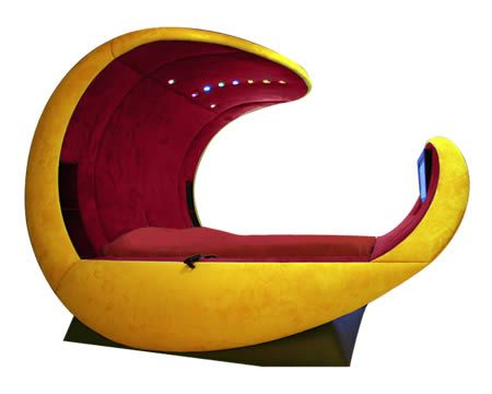 """We spend around a third of our lives asleep... but that can't justify spending $60,000 on a bed, can it? The makers of Cosmovoide think it can. Their luxury bed is shaped like an egg (to either give you Morkian dreams, or wrap you up in cozy cosmic harmony or some such nonsense), has hammock-like suspending springs, seven rainbow-colored LEDs, a telephone, and a DVD/home theater set-up including a TV at its foot. Most fascinating? Its twin """"electric relaxation bed frames,"""" which just get the…"""