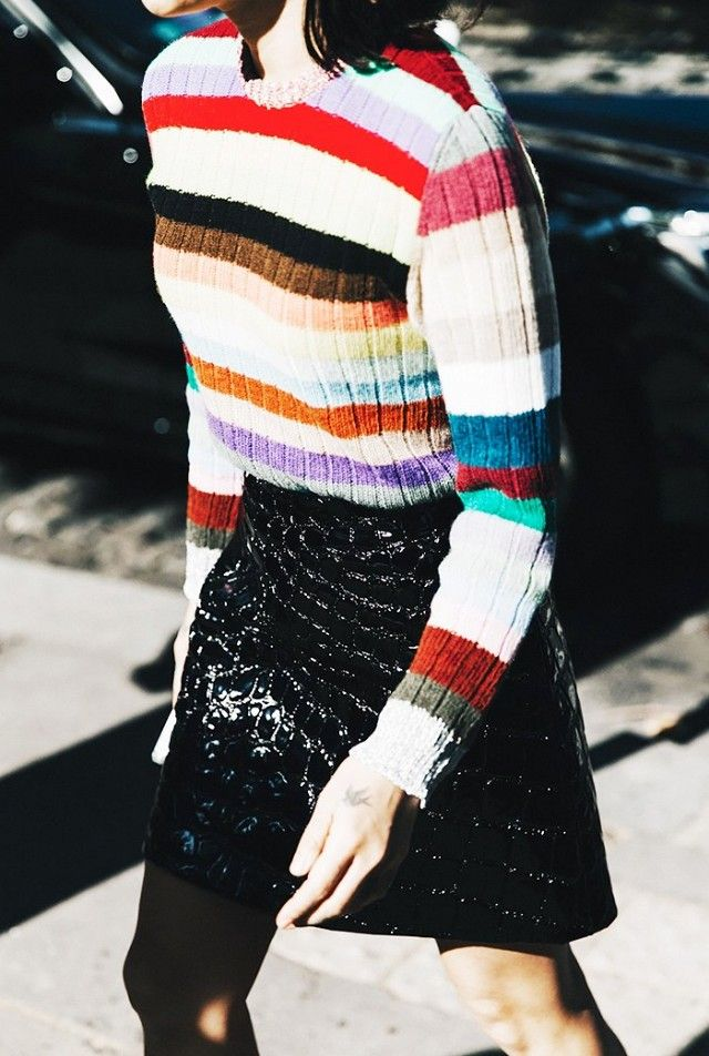 A rainbow striped sweater is paired with a stamped patent leather miniskirt