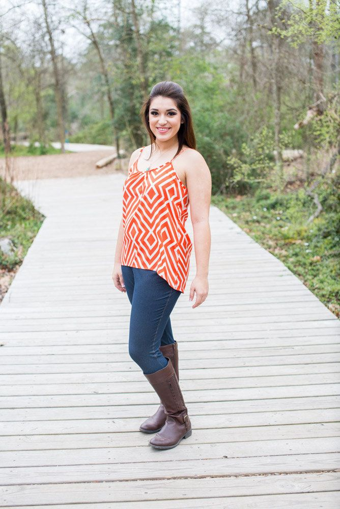 Jordan Tank  Adorable orange and white geometric tank is so flattering.  The color is bright and bold and features spaghetti straps and hi-low hemline.  So cute with jeans or with shorts.   Fit is true to size.  Angelika wearing a medium