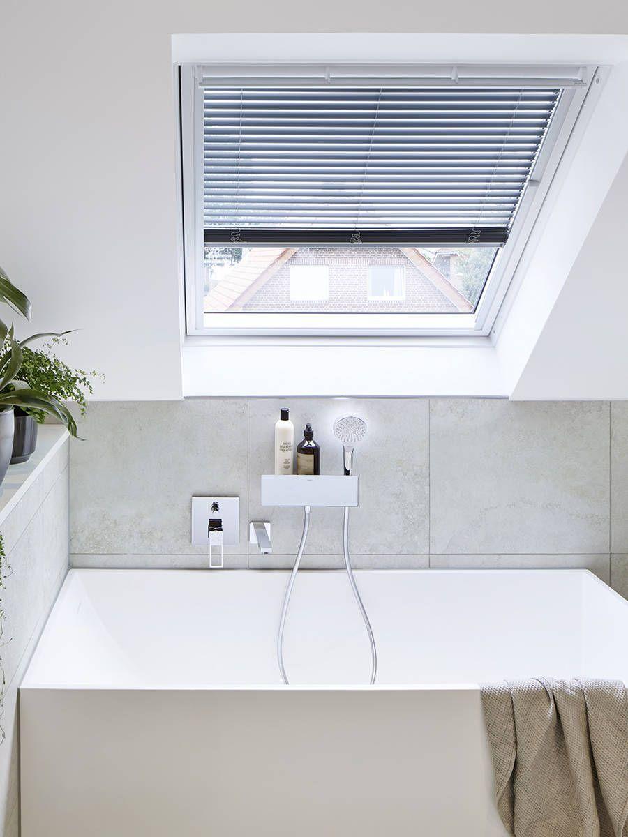 Modern bathroom mixer on the bathtub in a bright bathroom with ...