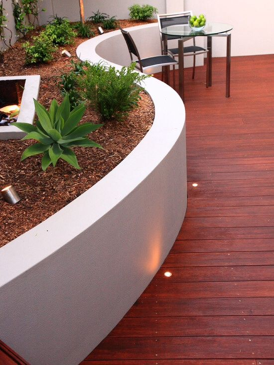 Great Modern Deck With Red Stained Wood Decking Raised Beds Concrete Retaining Walls Concrete Patio Poured Concrete Patio