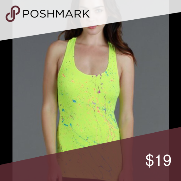 Paint Splatter Tank Top In Yellow This fun paint splatter tank with make a statement.  Soft and lightly ribbed with splatters of colors in a racer back strap.  Slimming and flattering as it fits to your body.  92% Nylon  8% Spandex  Hand wash in cold water  Line dry Nikibiki Tops Tank Tops