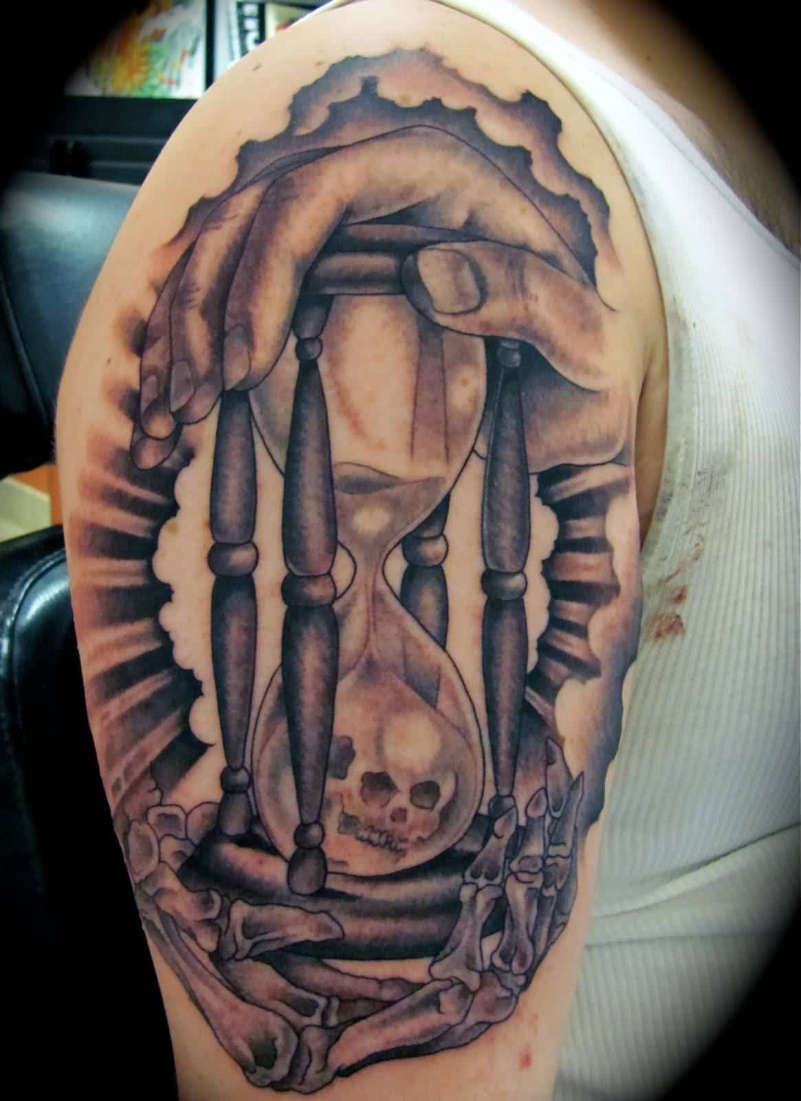 Full Sleeve Tattoo Definition: Black And Grey Skull In Hourglass Tattoo On Half Sleeve