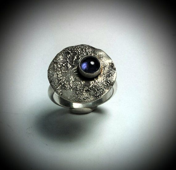 Check out this item in my Etsy shop https://www.etsy.com/listing/463035502/iolite-and-reticulated-sterling-silver