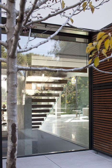 Windows are hidden behind timber screens that fold back in all ... on