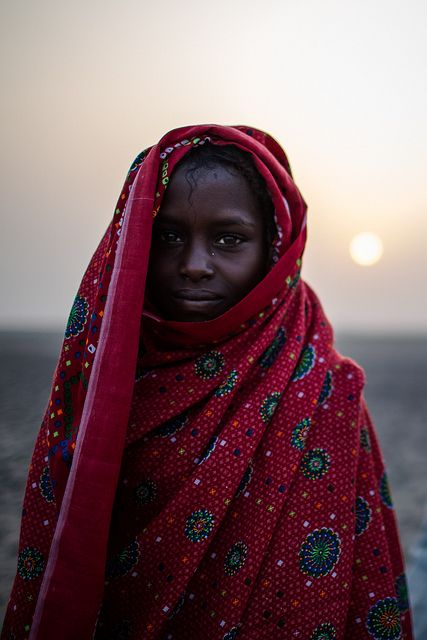endilletante:Afar girl wrapped in a cloak in Danakil depression by anthony pappone photography on Flickr.