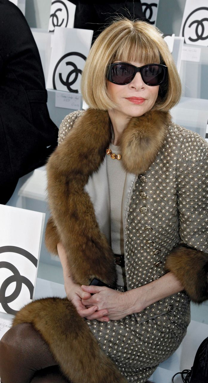 Anna Wintour, Editor in Chief of Vogue.Attending a Chanel show with her always perfect bob, the shades and the ever present fur.