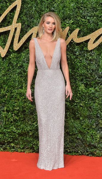 559af4b8 Rosie Huntington-Whiteley cut a sleek figure in a plunging V-neck silver  dress for a showstopping gown. Sign Up for Our Newsletter