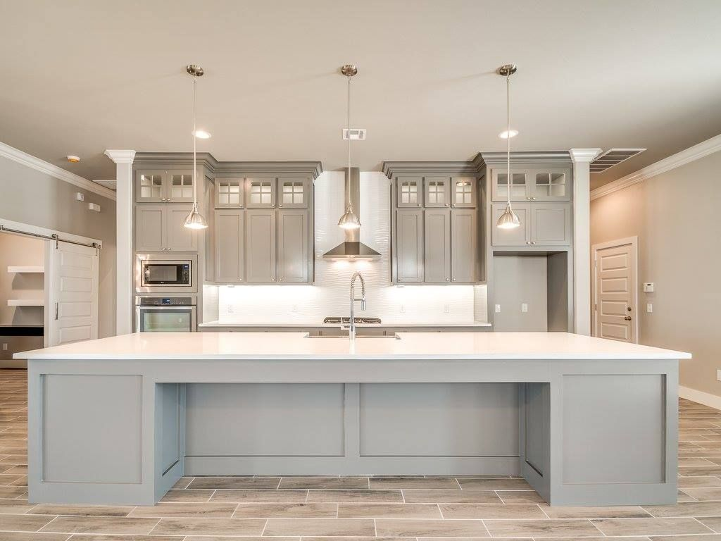 love open modern kitchen clean lines and grey tones large island for meal prep and kids on kitchen remodel with island open concept id=24364